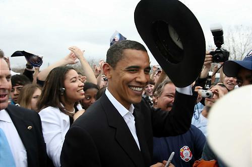 Obama_putting_on_hat